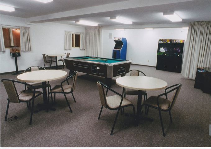 A games room with arcade games and pool table, prior to the space being converted into a communal kitchen.