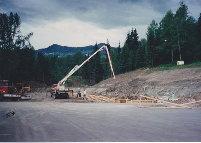 Image showing concrete crane pouring foundation of Fernie Fox Hotel during construction.