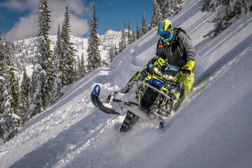 Snowmobiler tackling a sidehill.