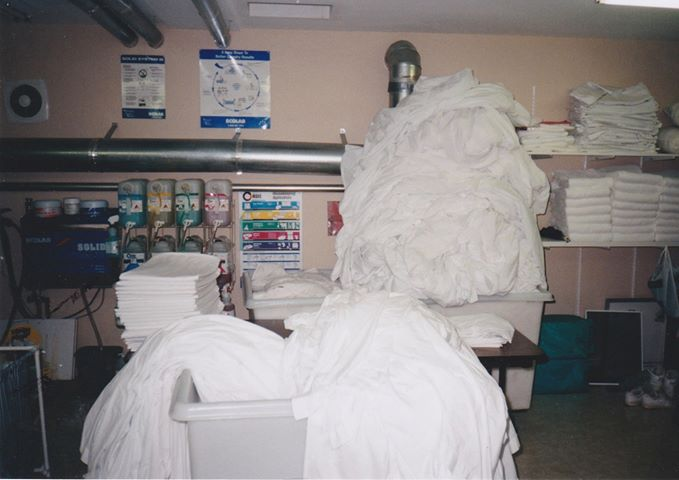 Image of laundry stacked almost to the ceiling.